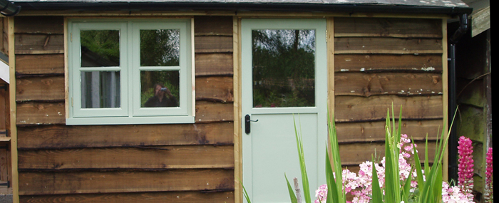 Wooden shed and hardwood casement windows